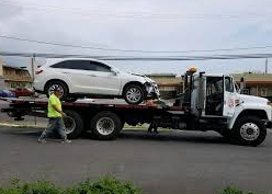 How to perform lift flatbed towing services?